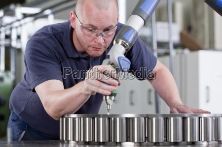 technician using measurement probe in steel