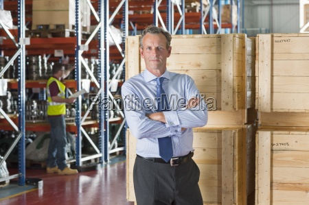 portrait of serious businessman with arms
