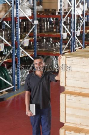 portrait of smiling worker holding digital
