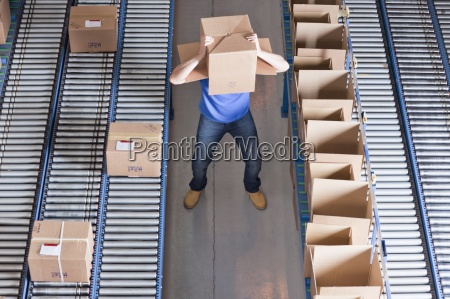worker with box covering head near