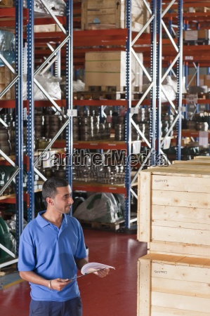 smiling, worker, holding, clipboard, and, checking - 12917740
