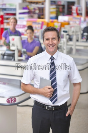 portrait of supermarket staff at checkout