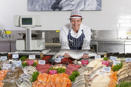 fishmonger in fresh fish department of