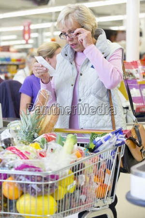 shocked customer with shopping at supermarket