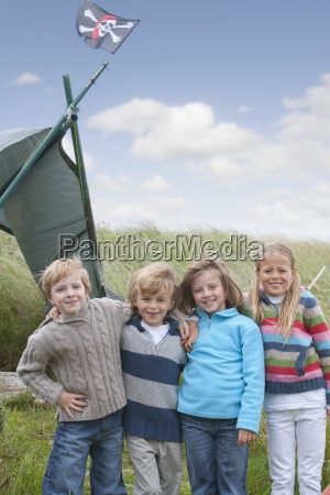 group of children standing in dunes