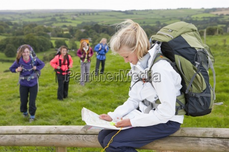 girl with backpack looking at map