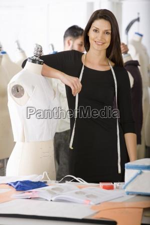 fashion designer working on garment on