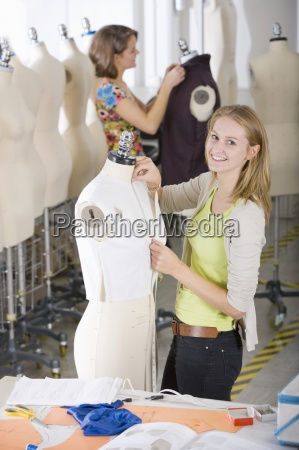 fashion design student working on garment
