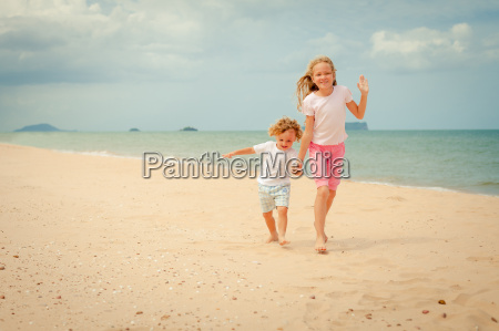 two happy kids playing at the