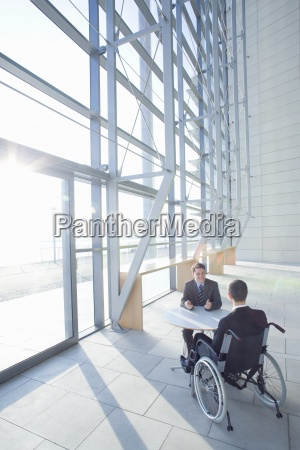businessman in wheelchair meeting with co