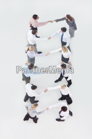business people in rows shaking hands