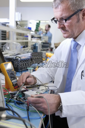engineer working at electrical test bench