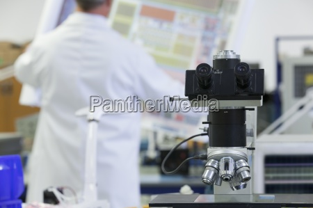 engineer examining circuit diagram in laboratory