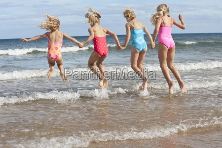 girls in bathing suits splashing in