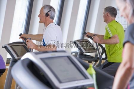 seniors exercising on cross training machines