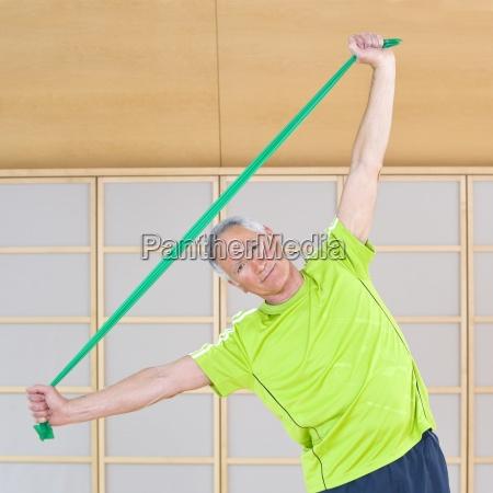 portrait of senior man exercising with