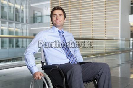 smiling businessman in wheelchair