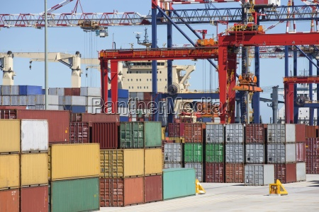 cranes and cargo containers alongside container