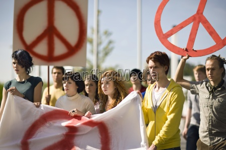 group of young people holding banner
