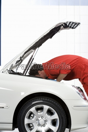 male care mechanic in red overalls