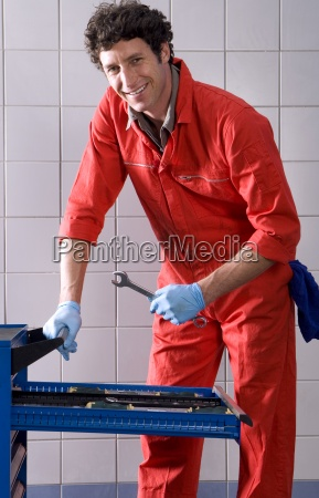 male car mechanic in red overalls