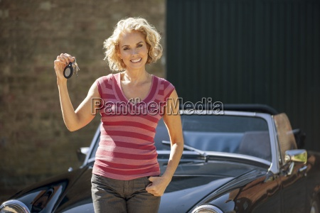 a mature woman holding the keys