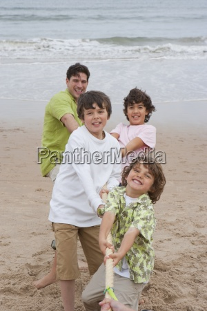 father and sons taking part in