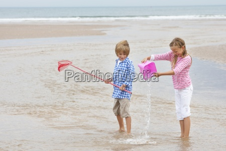 two children playing in sea with