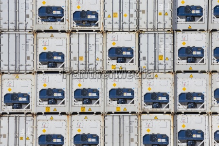 full frame of stacked cargo containers