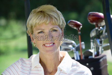 mature woman sitting in golf buggy
