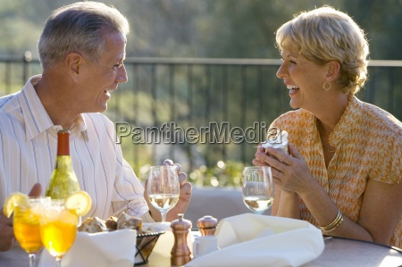 mature couple dining at outdoor restaurant