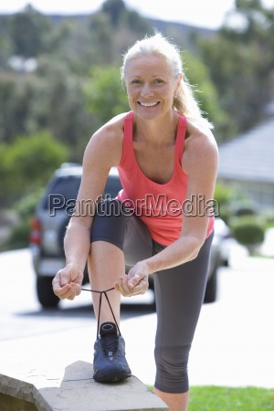 active senior woman in pink sports
