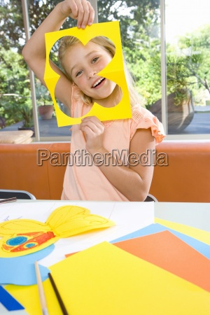 girl6 8 holding up paper cut
