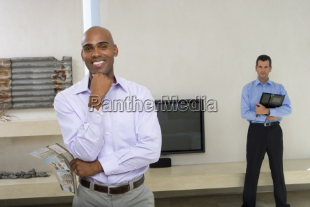 man standing in living room smiling