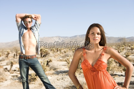 young couple in desert man with