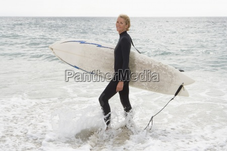 female surfer in shallow water on