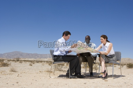 two businessmen and woman on chairs