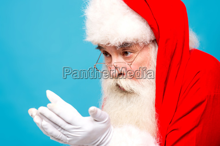 santa claus looking his open palms