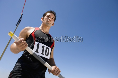 young male athlete with pole low