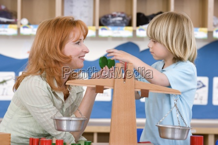 teacher playing with boy 3 5