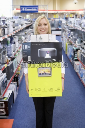 young woman with boxes in shop