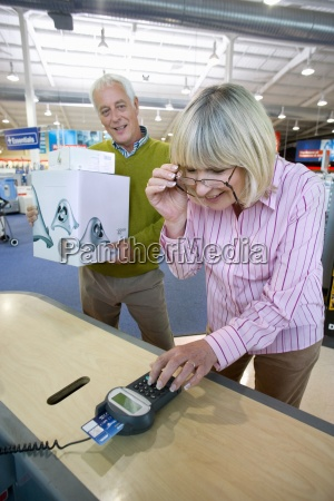 mature woman paying with chip and