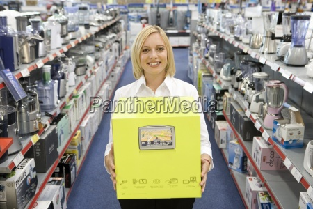 young woman with box in electronics