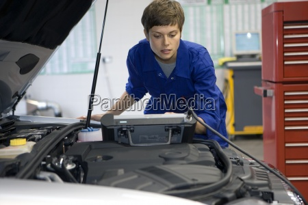 female mechanic with diagnostic computer by