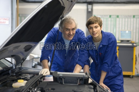 mechanic and colleague with diagnostic computer