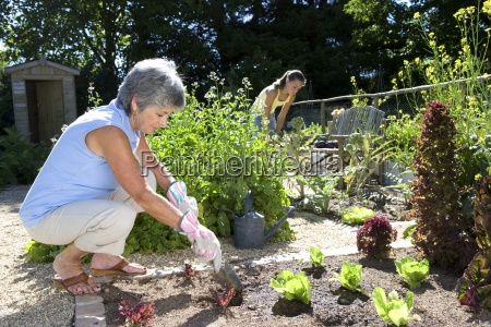 mother and daughter 10 12 gardening