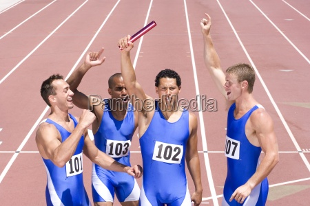 group of male athletes with arms