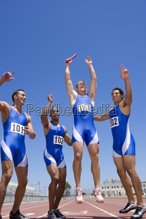 young male runners cheering after winning