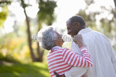senior couple arm in arm low