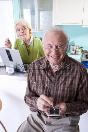 senior couple with laptop computer and